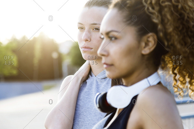 Portrait of two confident sporty young women