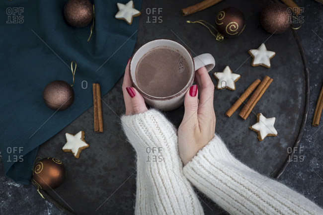 Woman\'s hands holding cup of Hot Chocolate at Christmas time