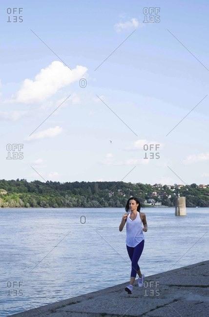 Woman jogging on the river bank- Danube river- Novi Sad- Serbia