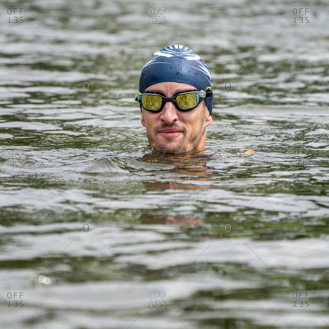 Young triathlete in a lake