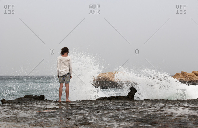Rear view of man standing at seafront- Gulf of Oman- near Sur- Oman