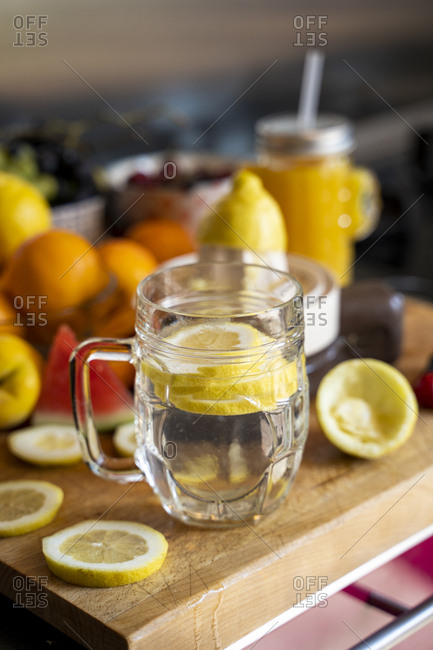 Lemon infusion on kitchen table with various fruit