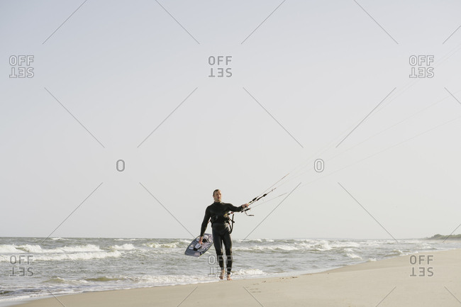 Kite boarder walking with his kite at the beach