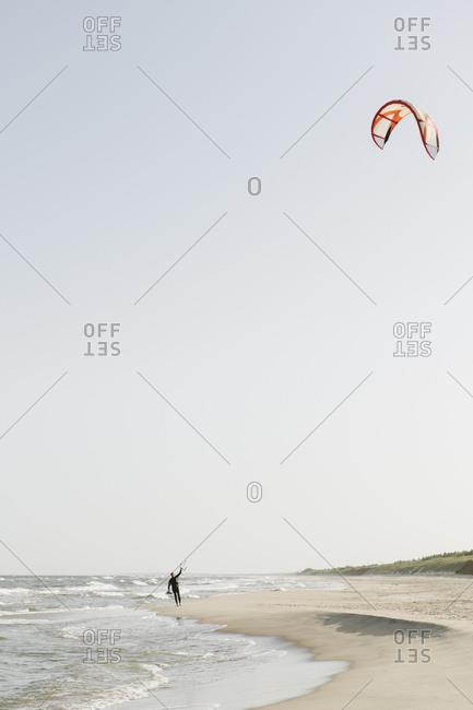 Kite boarder preparing his kite at the beach