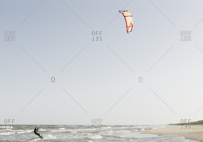 Kite boarder riding the waves