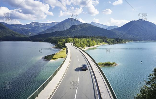 Aerial view of a car crossing a bridge- Sylvenstein Dam- Bavaria- Germany