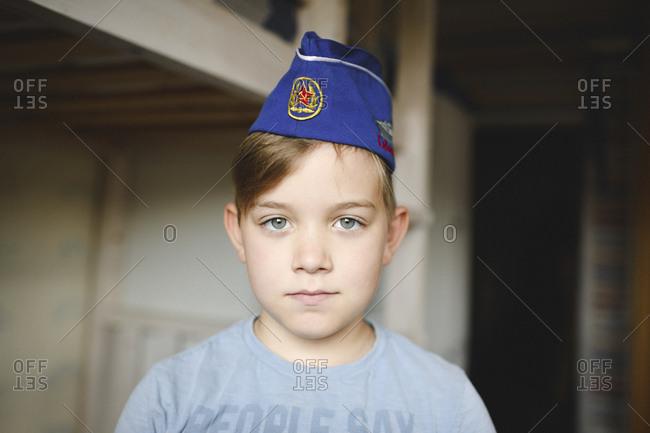 Portrait of a boy wearing a Russian cap