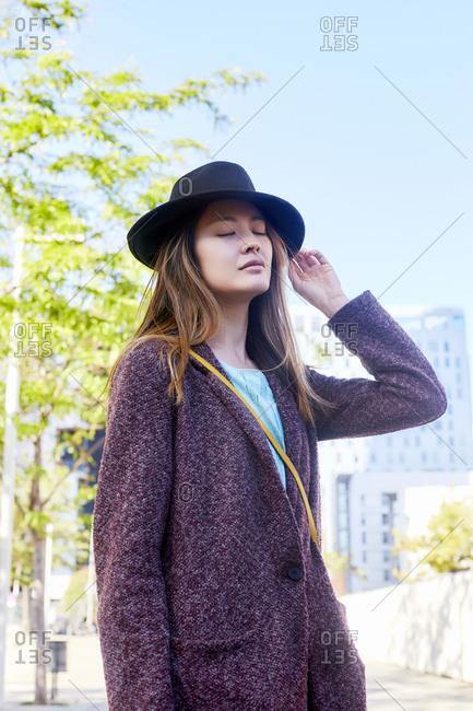 Dreamy woman wearing a hat- Barcelona- Spain