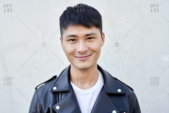 Portrait of confident young man wearing a leather jacket