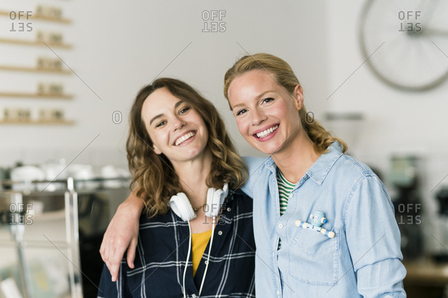 Two young women standing proud in their own coffee shop