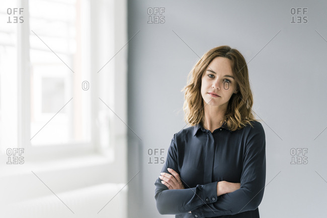 Young woman with arms crossed- looking sad