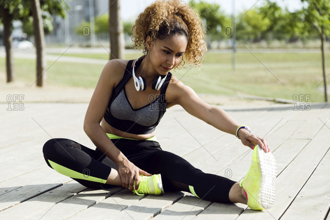 Sporty woman stretching in the park