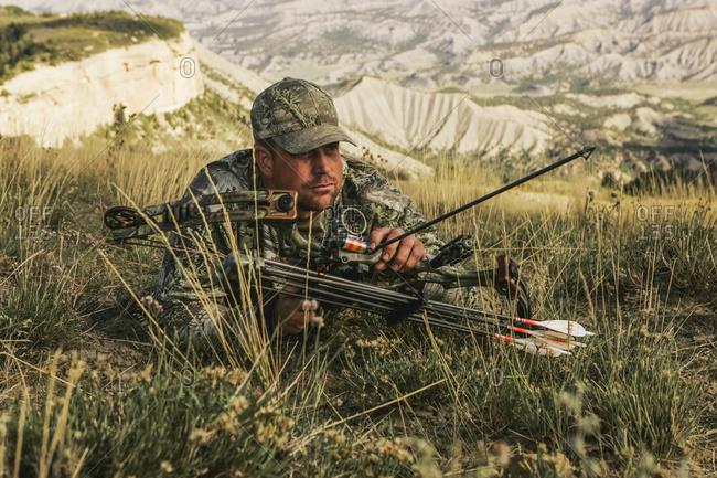 Elk Bowhunter Belly Crawling - Offset