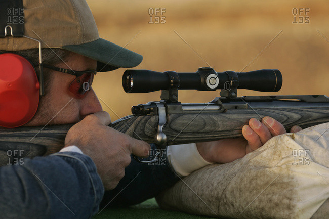 Man Shooting Rifle On Shooting Range