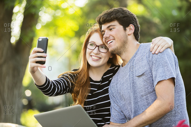 A young man and young woman taking a selfie