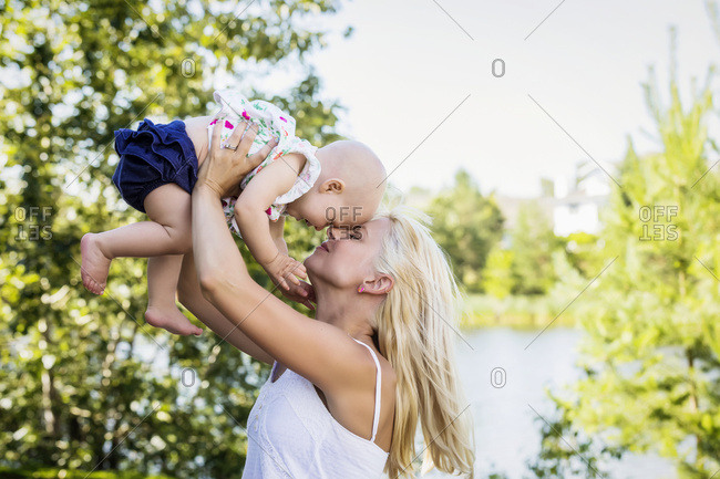 A beautiful young mother enjoying quality time with her cute baby daughter