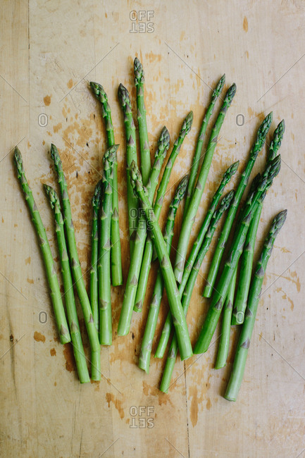 Bunch of fresh cut garden asparagus on a wooden cutting board