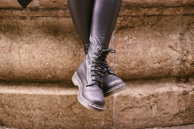Close-up of dr. Martens boots on female legs