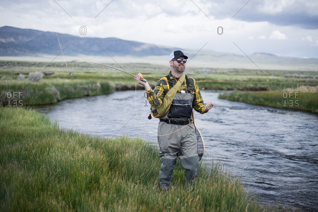 A fly fisherman on beautiful a river.