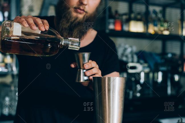 Barman Preparing a Mojito In A Cocktail Bar.