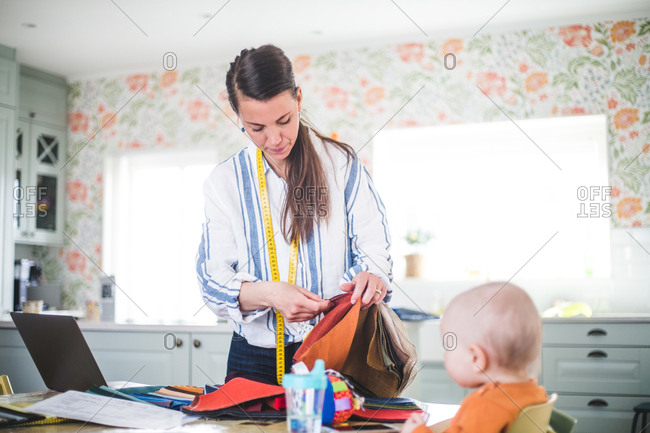 Female design professional working with daughter at home office