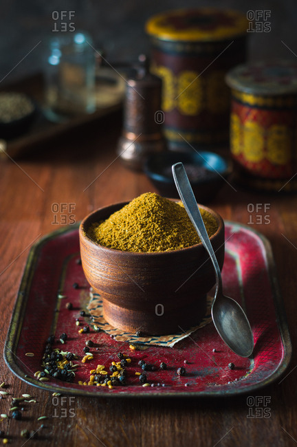Homemade curry powder mix in a wooden bowl
