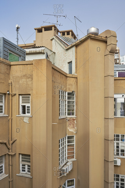 Apartment building with peeling stucco in Lisbon, Portugal