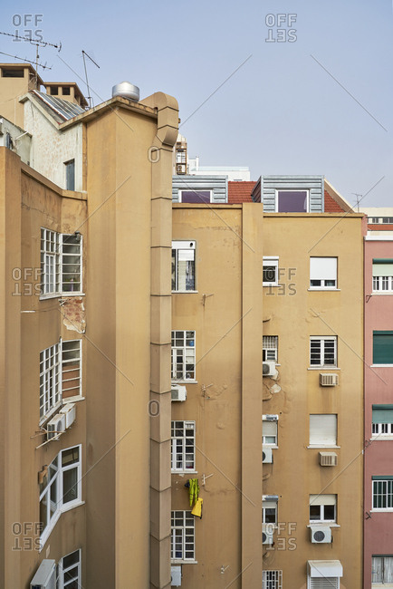 Exterior of apartment building with peeling stucco in Lisbon, Portugal
