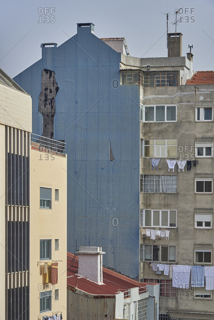 Facades of apartment building with clotheslines in Lisbon, Portugal