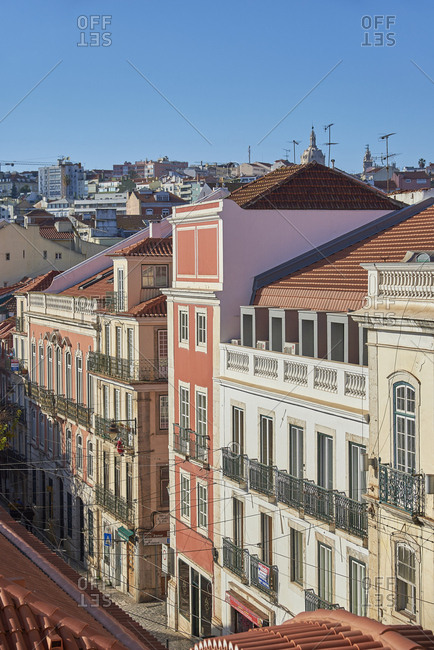 Lisbon, Portugal - December 28, 2018: Bird's eye view of colorful facades of buildings at sunset