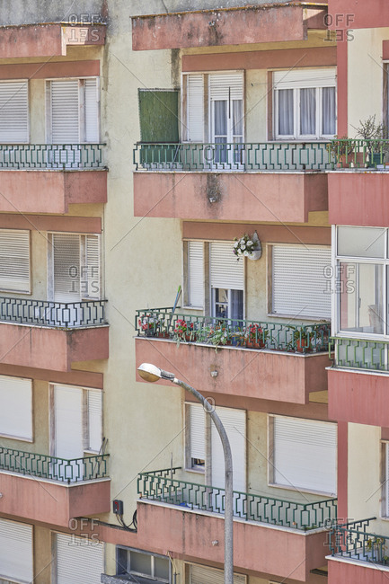 Facade of apartment building with balconies in Lisbon, Portugal