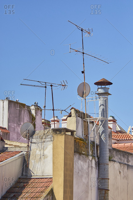 Cluster of antennas and satellite dishes on Lisbon rooftops, Portugal