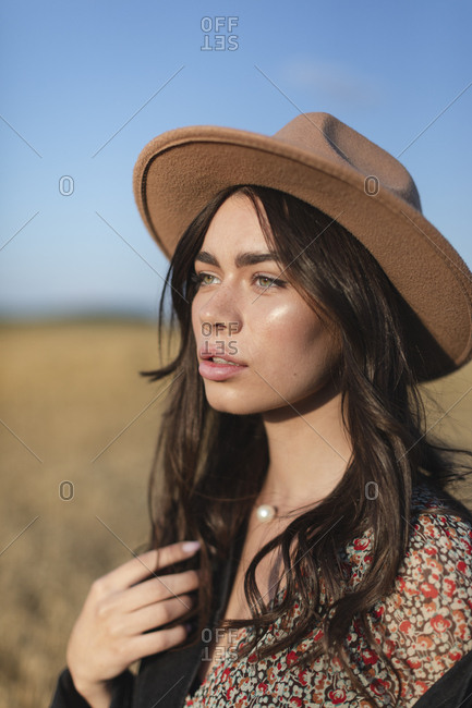Portrait of a beautiful young woman in stylish hat