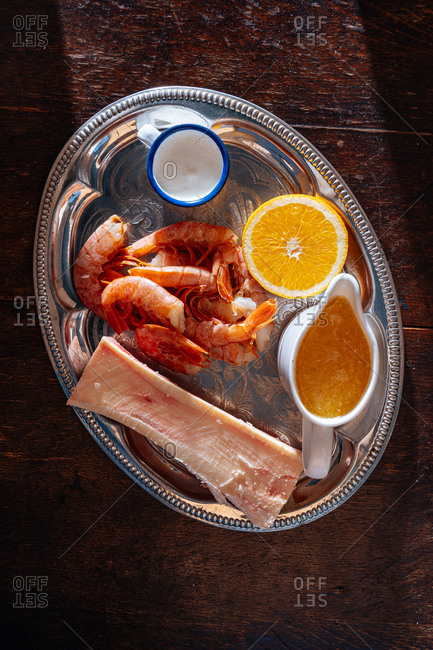 Shrimp and other ingredients on a silver platter