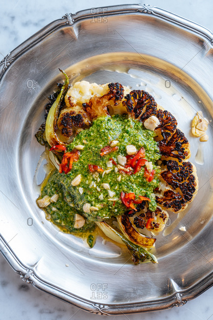 Grilled gourmet cauliflower dish on a silver plate