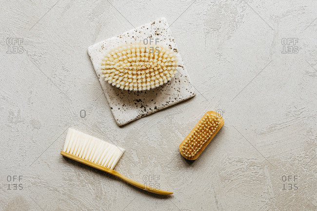 From above photo of composition with wooden bathing brushes.
