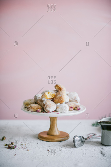 Fresh baked heart shaped donuts on a stand