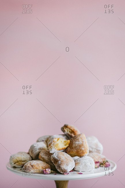Heart shaped donuts on a pink background