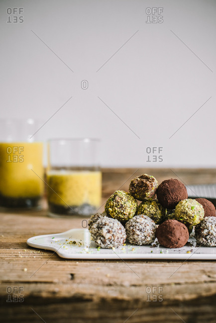Variety of fresh baked truffles on wooden surface