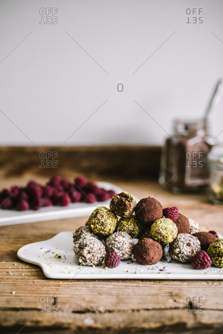 Variety of fresh baked truffles and raspberries