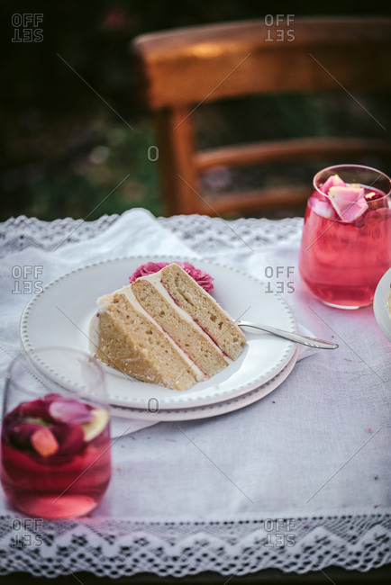 Slice of cake and wine on an outdoor table