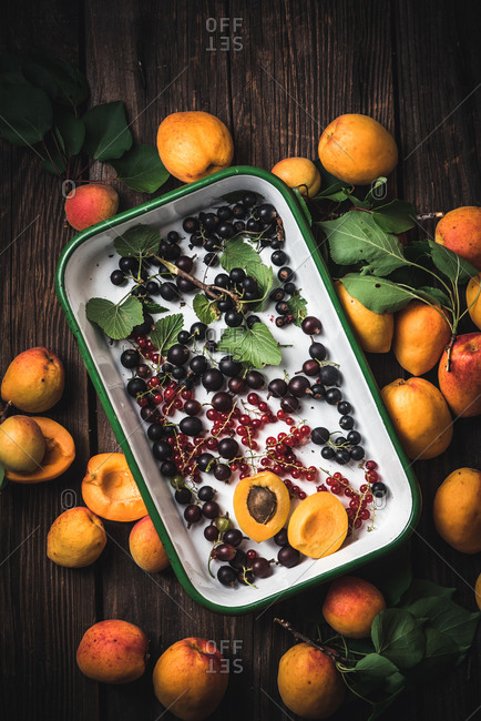 Variety of berries and stone fruit in a baking dish