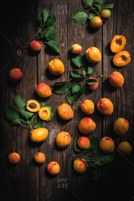 Stone fruit on a wooden surface
