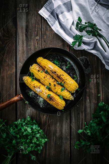 Corn on the cob cooked in a skillet