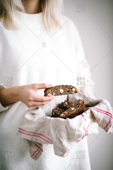 Woman holding biscotti in a towel