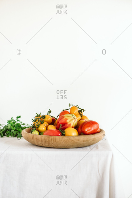 Wooden bowl filled with colorful vegetables