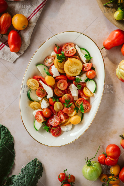 Dish filled with colorful vegetables