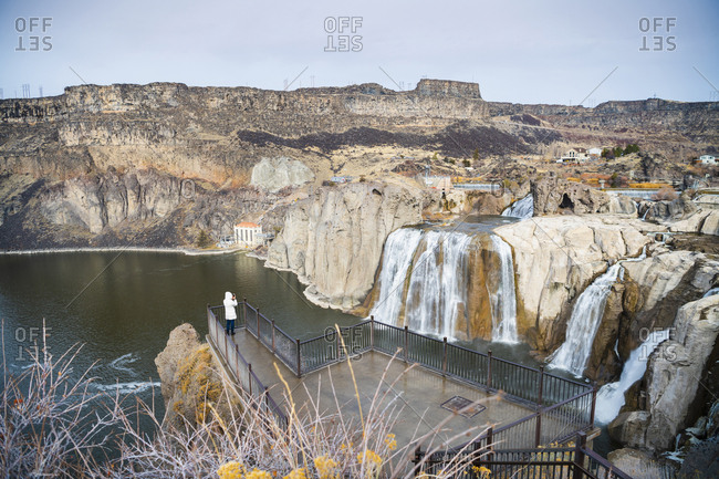 Woman looking at Shoshone Falls while standing in observation point