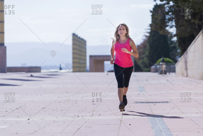 Female runner during urban workout.