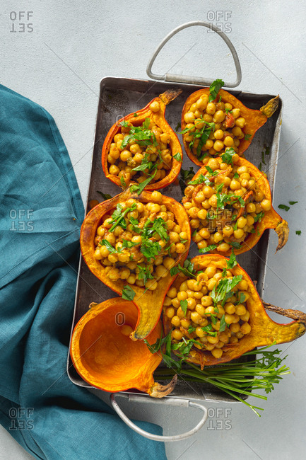 Vegetarian stuffed pumpkin chickpea curry in baking dish